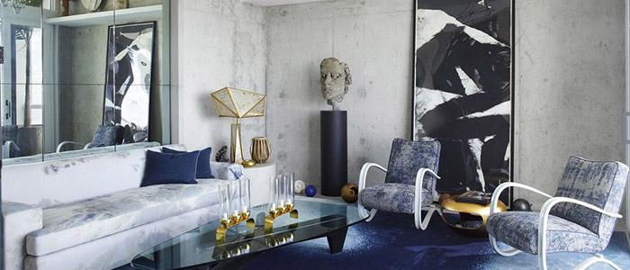phòng khách sử dụng màu bê tông và xanh navy